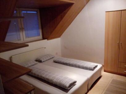 Posteľ alebo postele v izbe v ubytovaní Penzion-Ubytovanie U SOVY