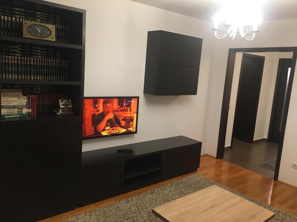 Un televizor și/sau centru de divertisment la Nordic1