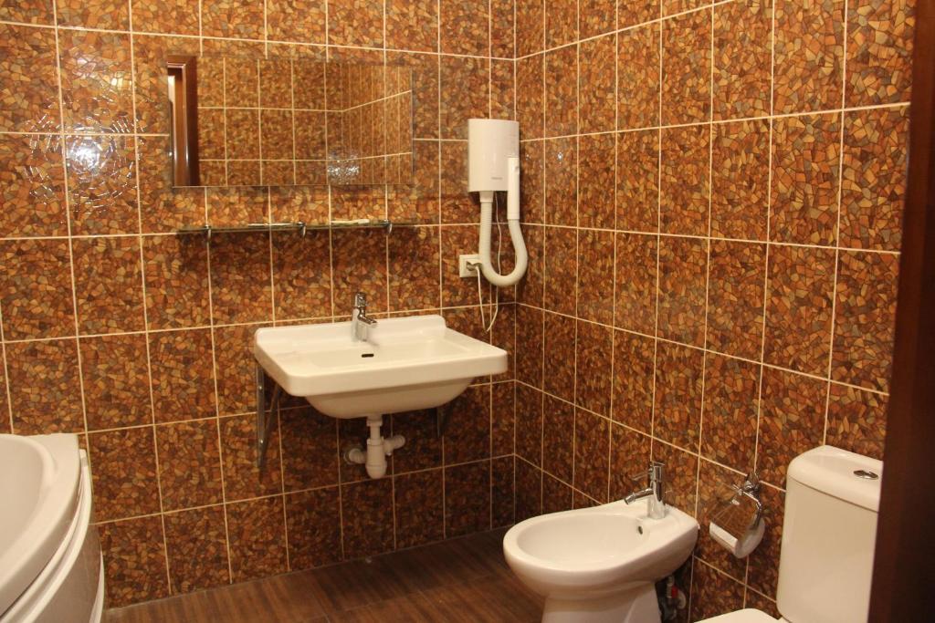 A bathroom at Лесная Поляна Отель