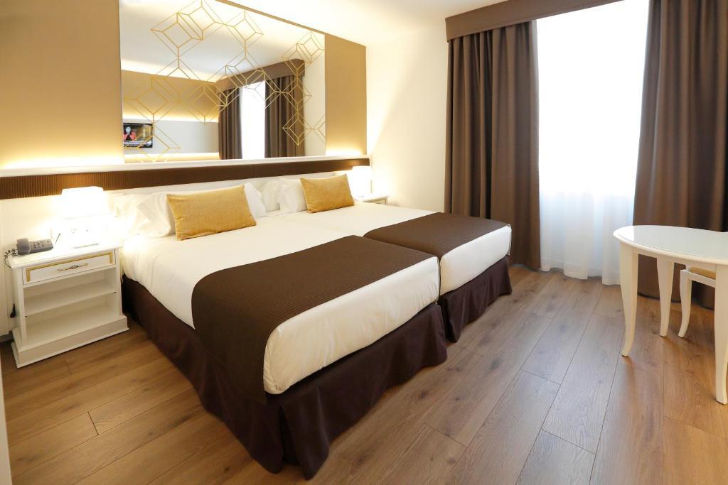 Sercotel Alfonso XIIIにあるベッド
