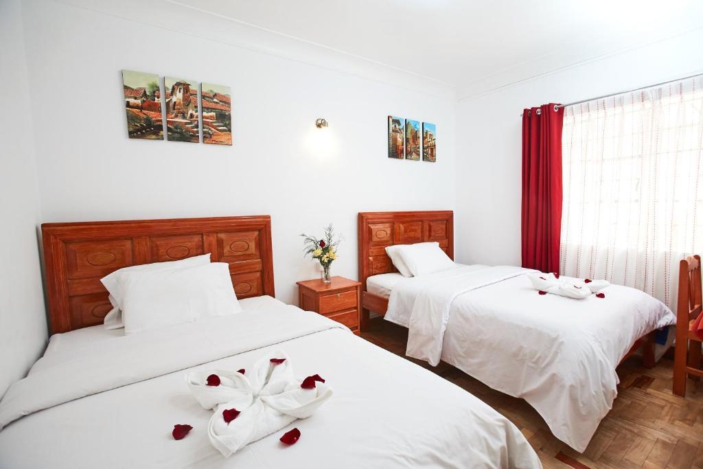Cama o camas de una habitación en Hostal Danna Inn