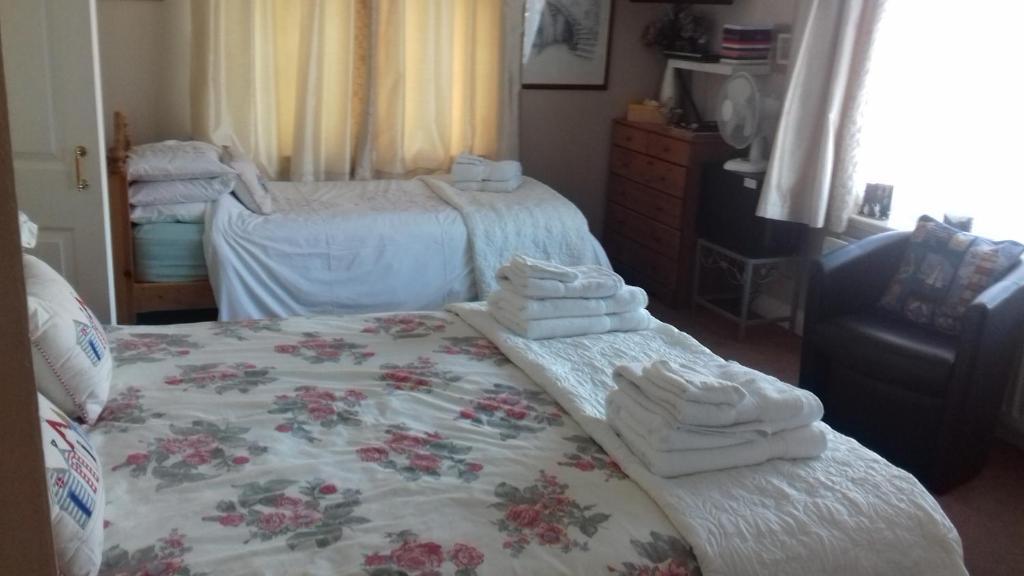 Ein Bett oder Betten in einem Zimmer der Unterkunft The Bell Pub Grimston
