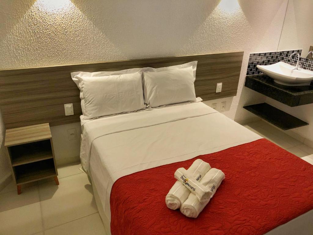 Cama ou camas em um quarto em Pousada Paraíso Maragogi