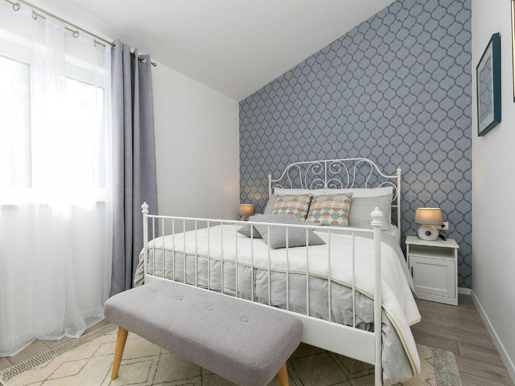 A bed or beds in a room at Holiday Dream