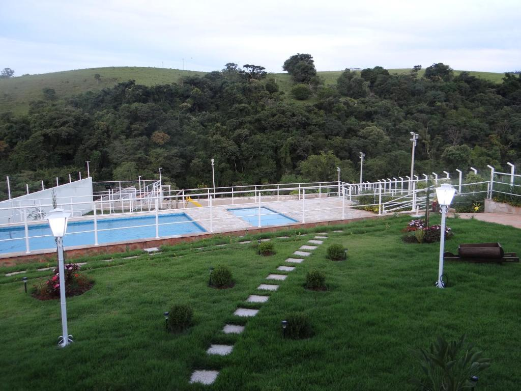 The swimming pool at or near Pousada Canto dos Canários