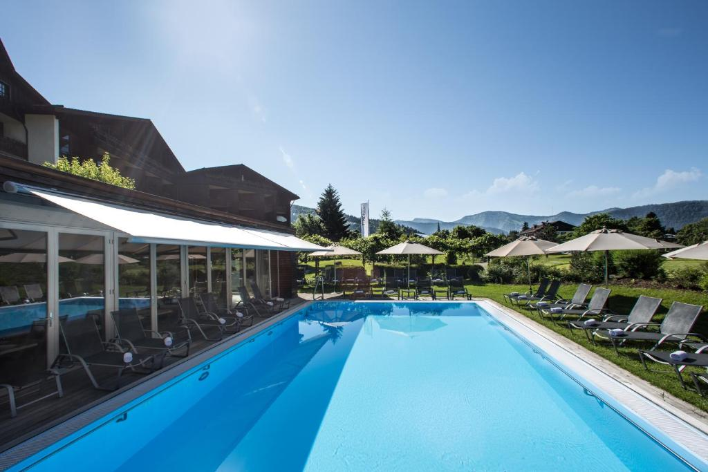 The swimming pool at or near Lindner Parkhotel & Spa Oberstaufen