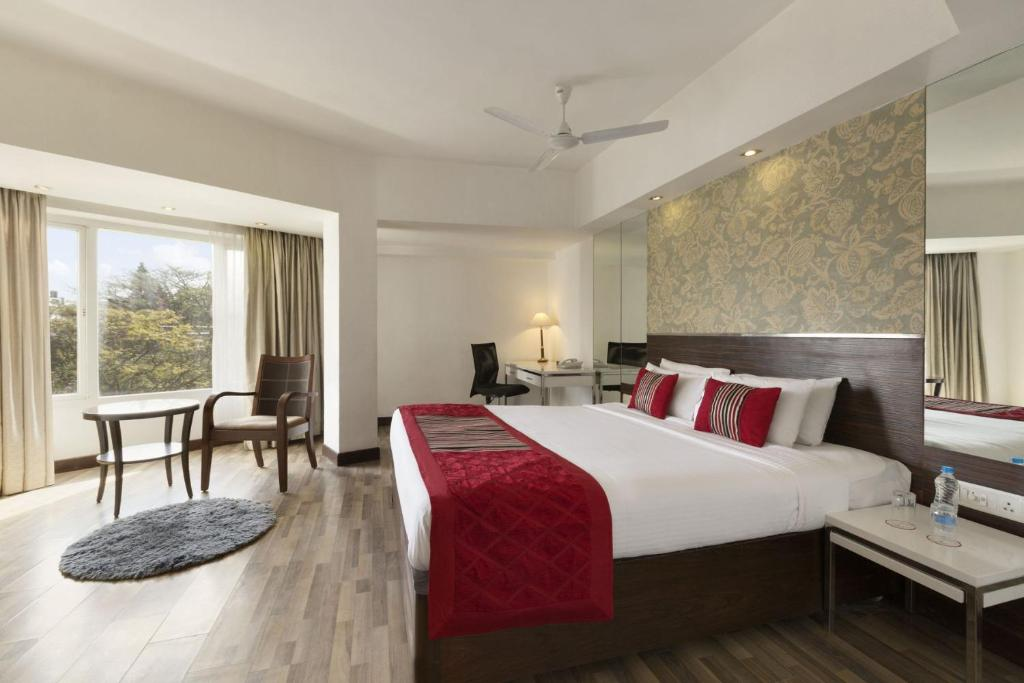 A bed or beds in a room at Regenta Place