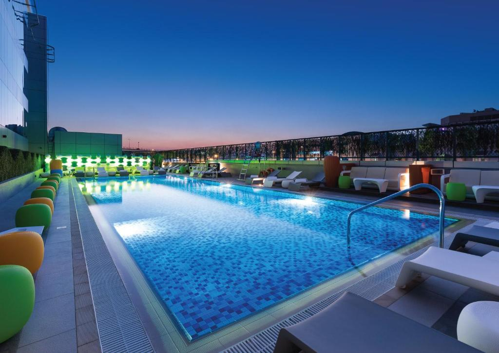 The swimming pool at or near Studio M Arabian Plaza Hotel & Hotel Apartments by Millennium
