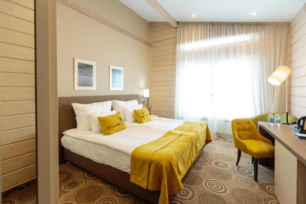 Кровать или кровати в номере Горки Гольф Курорт