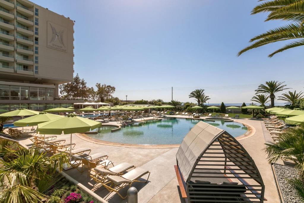 A view of the pool at Divani Apollon Palace & Thalasso or nearby