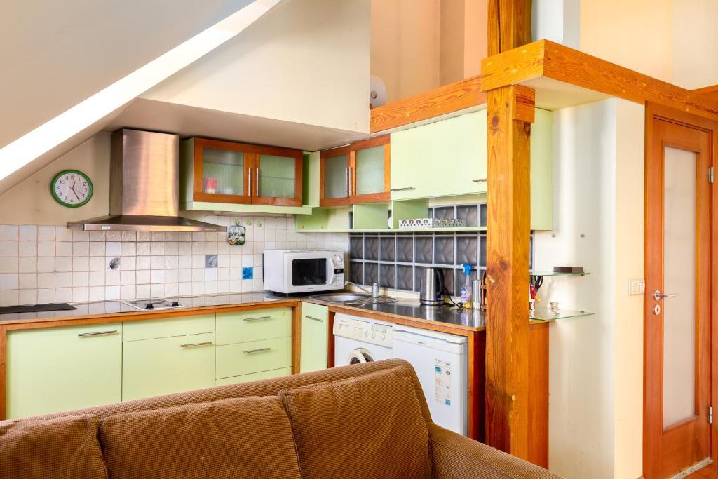 A kitchen or kitchenette at Designapartments