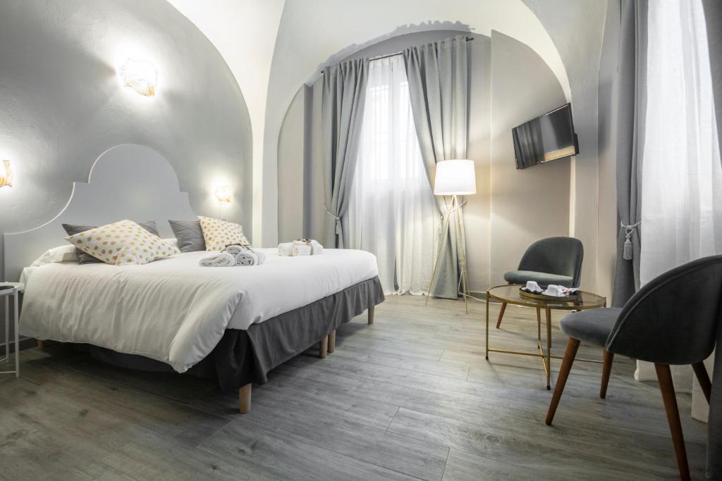 Letto o letti in una camera di la Lu cozy rooms