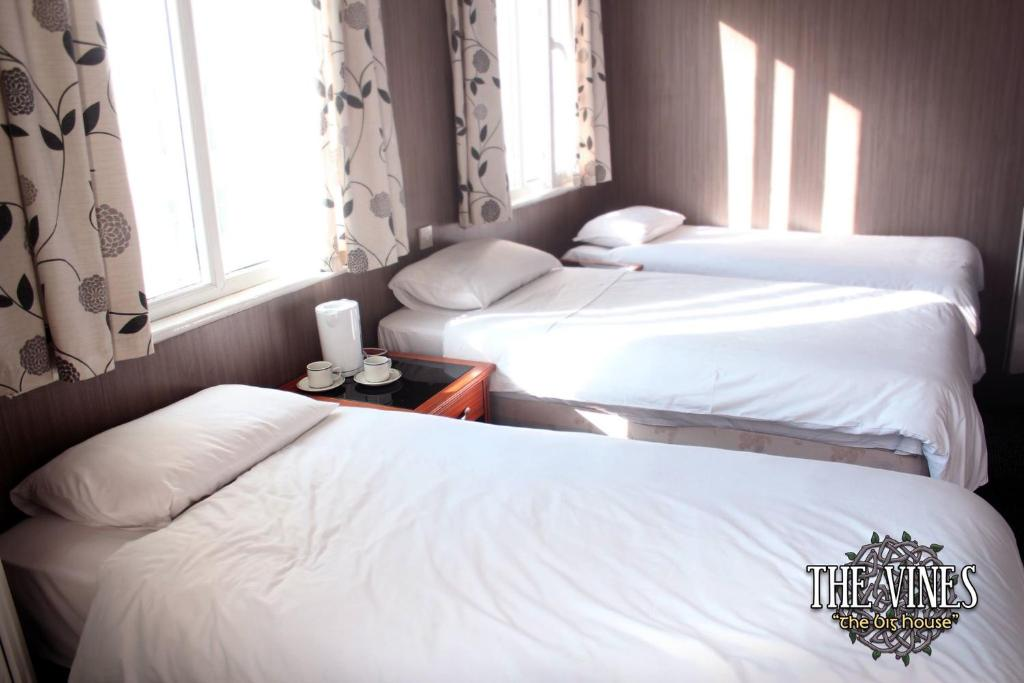 Ein Bett oder Betten in einem Zimmer der Unterkunft The Vines (The Big House)