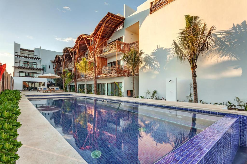 The swimming pool at or near Mystique Blue Holbox