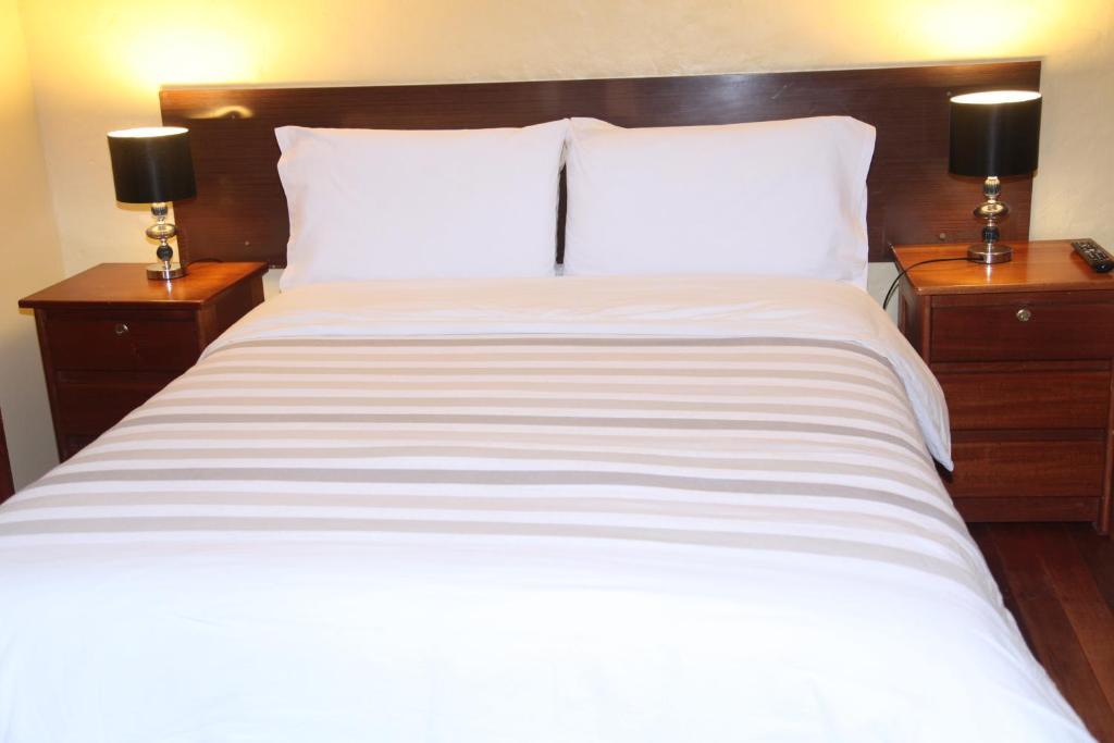Cama o camas de una habitación en Muyucmarka Hospedaje Familiar