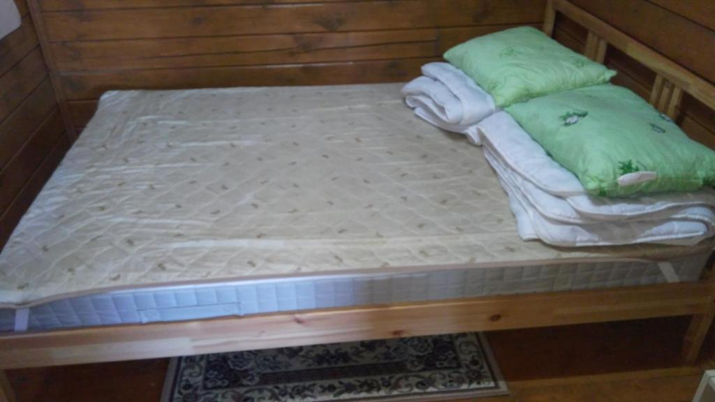 A bed or beds in a room at Guest House Belye Rosy