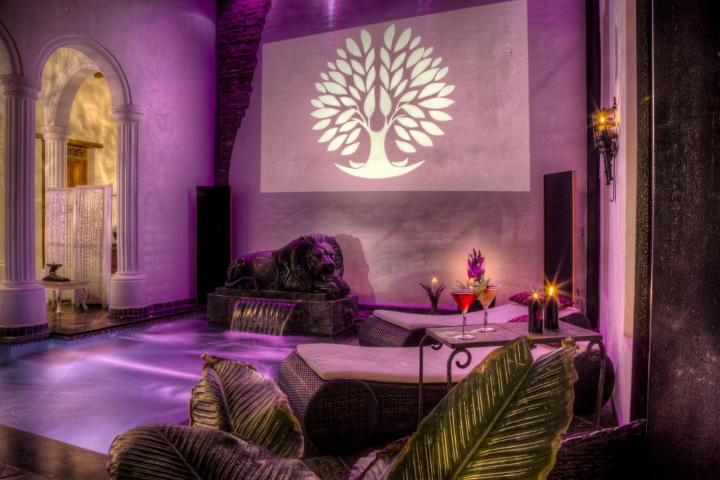 Ein Sitzbereich in der Unterkunft Casa de Leda, a Kali Hotel