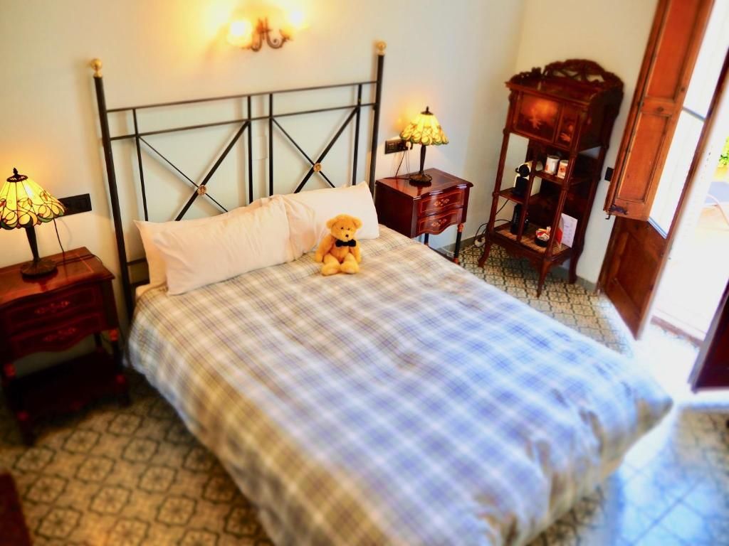 A bed or beds in a room at Hotel Liberty