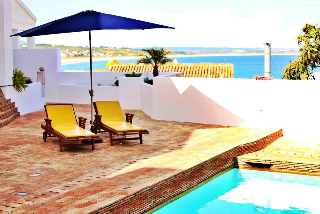 The swimming pool at or near Baluarte da Vila Apartments