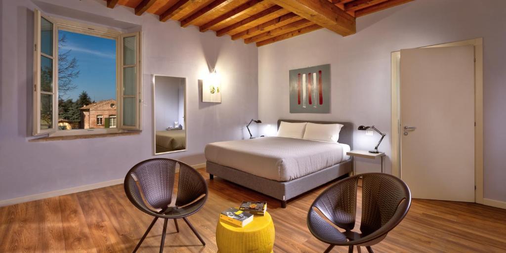 מיטה או מיטות בחדר ב-Hotel Cortaccia Sanvitale