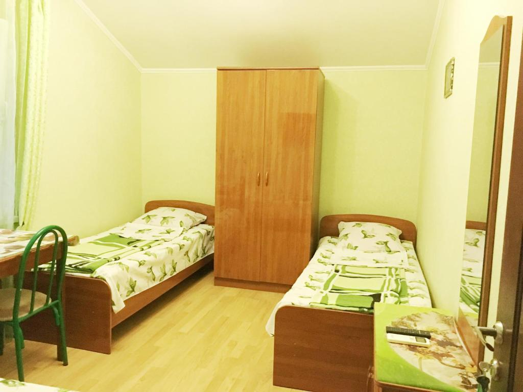 A bed or beds in a room at Liana Guest House