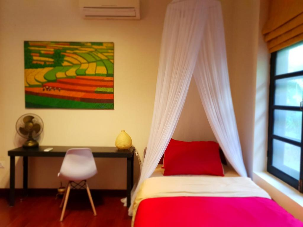 A bed or beds in a room at Cozy home in Yangon
