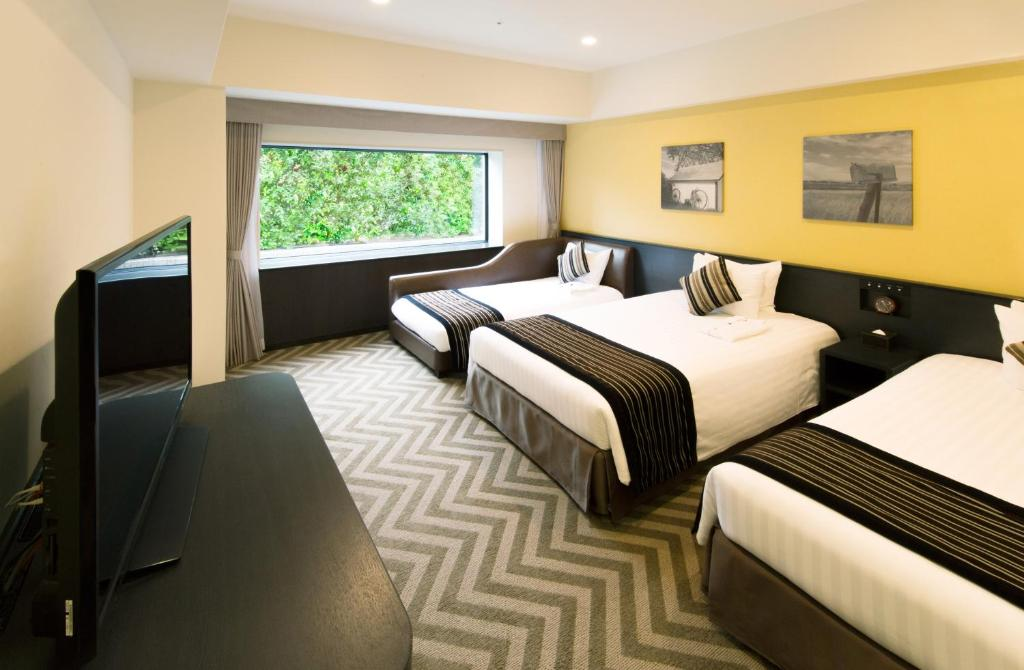 A bed or beds in a room at The Park Front Hotel at Universal Studios Japan TM