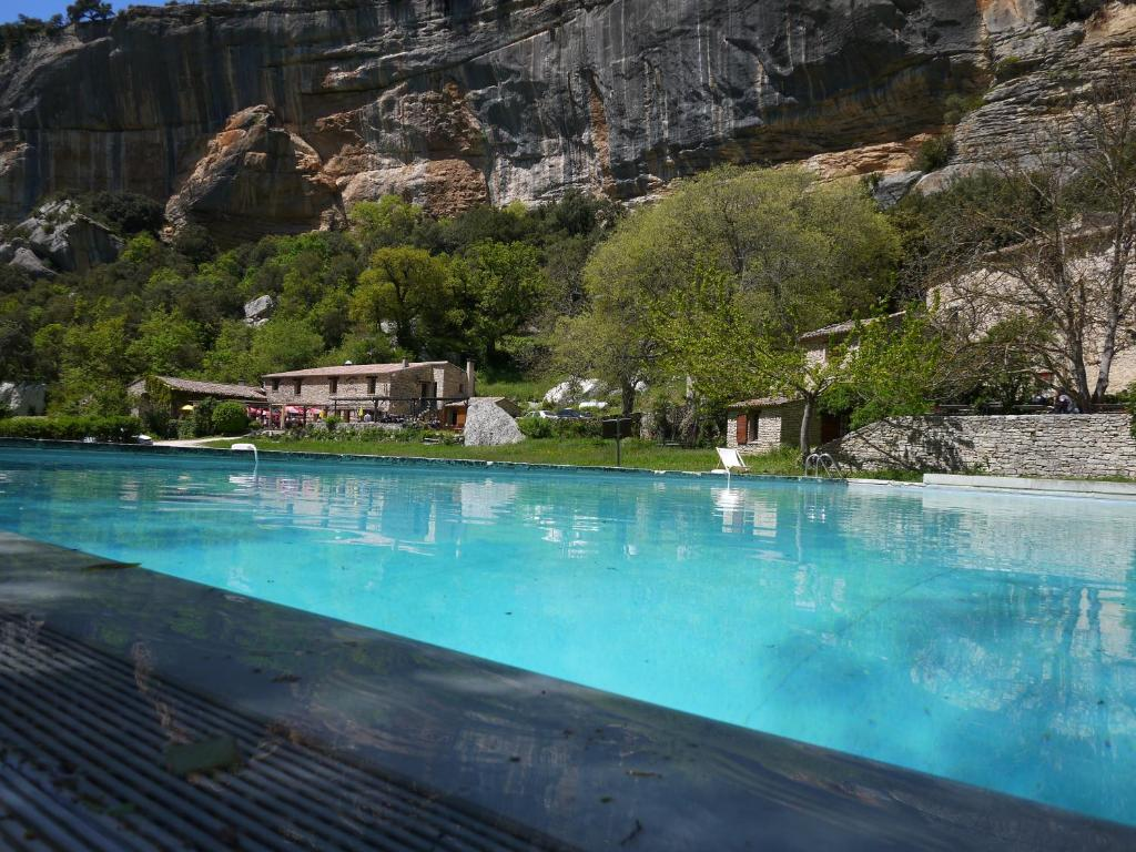 The swimming pool at or near Auberge des Seguins