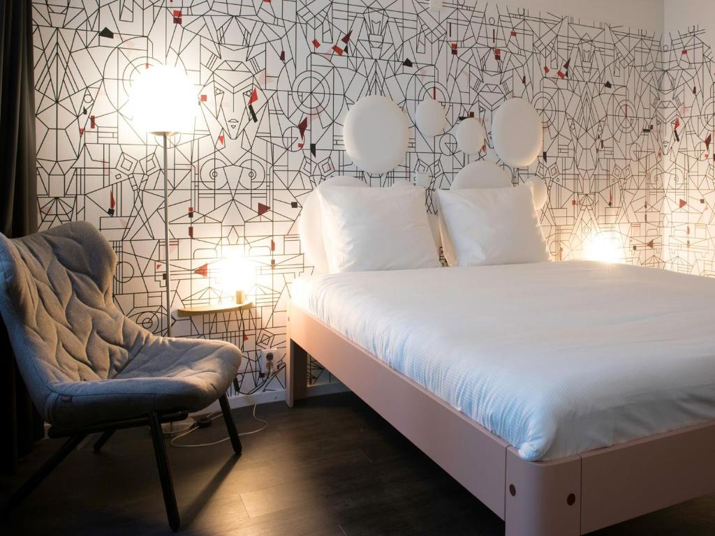 A bed or beds in a room at Mabi City Centre