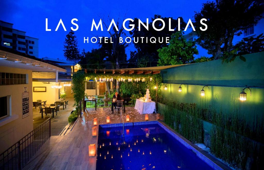 The swimming pool at or near Las Magnolias Hotel Boutique