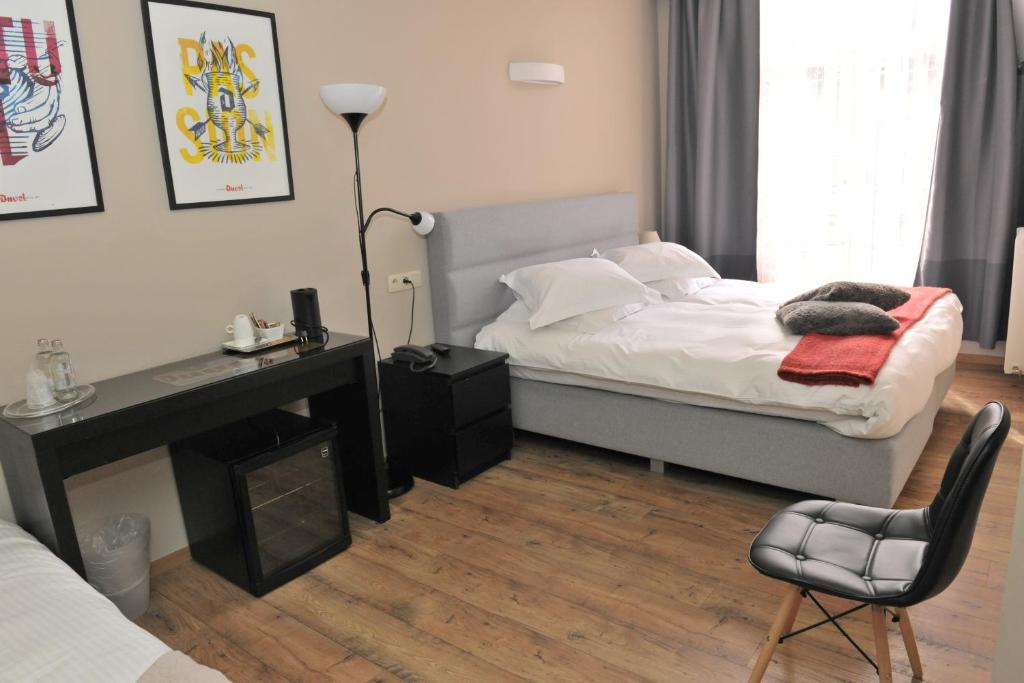 Cama ou camas em um quarto em Hotel Palace