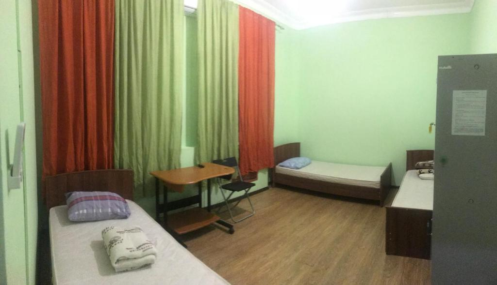 Кровать или кровати в номере Hostel Tourist