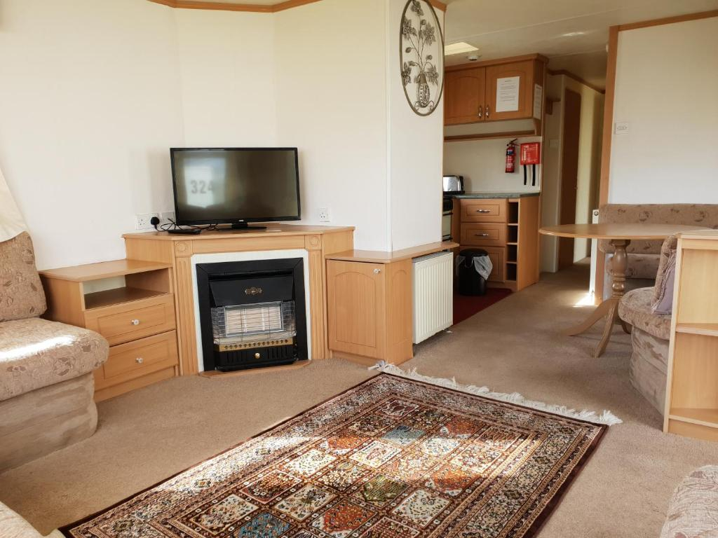 A television and/or entertainment center at Park Home at Family Holiday Park North Wales