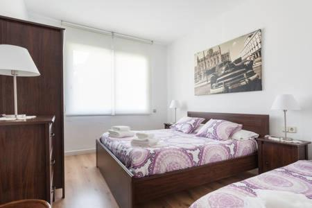 A bed or beds in a room at Piso Zona Plaza España, junto a Montjuic,