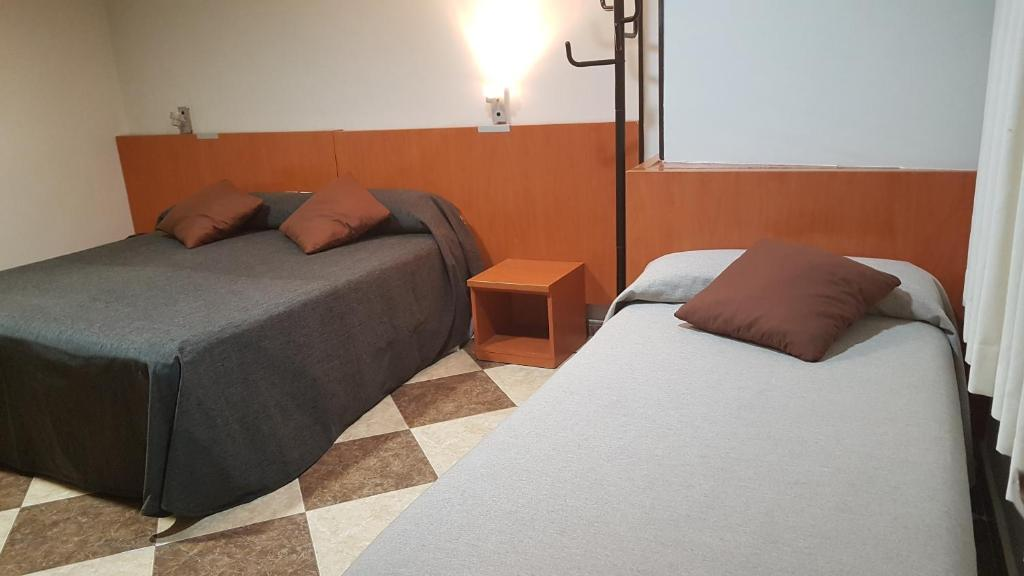 A bed or beds in a room at Hotel Juan Carlos