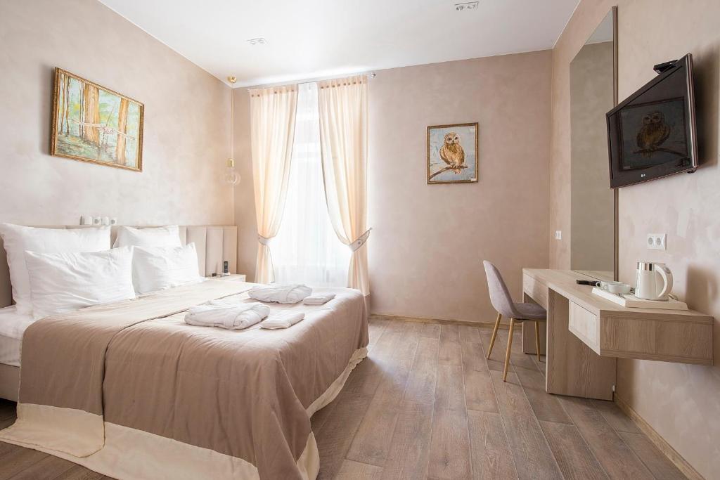 Un ou plusieurs lits dans un hébergement de l'établissement Hotel Grand Mark