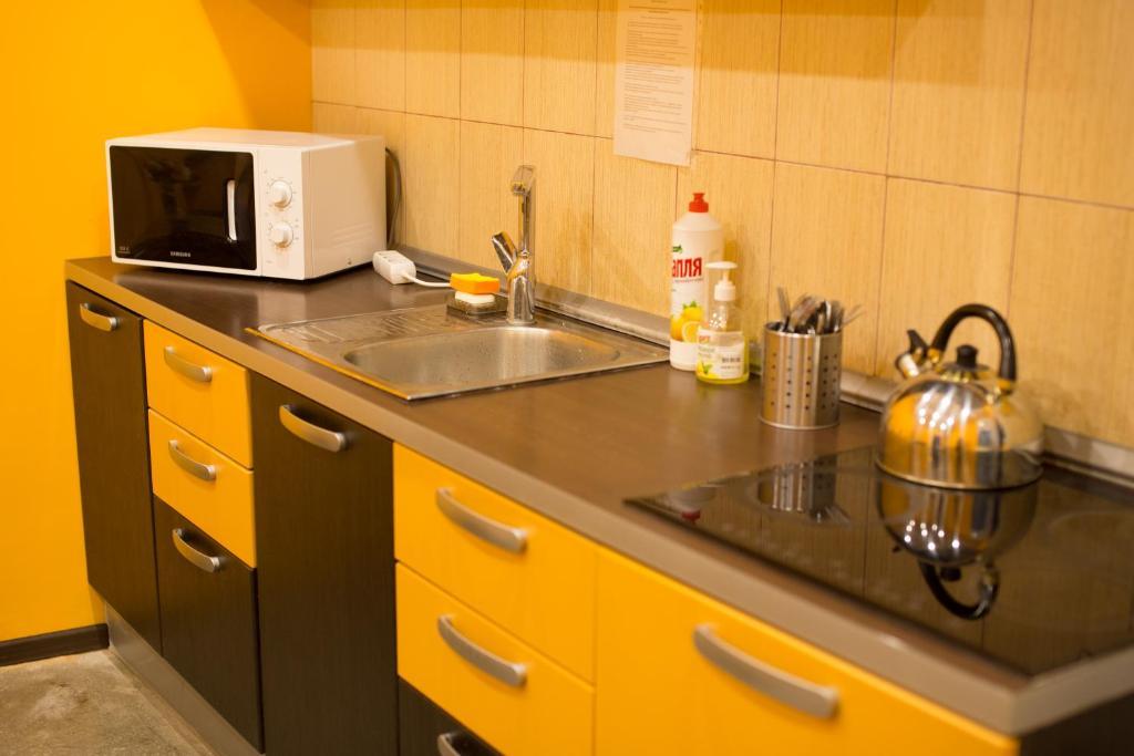 Кухня или мини-кухня в Хостел Tranzit