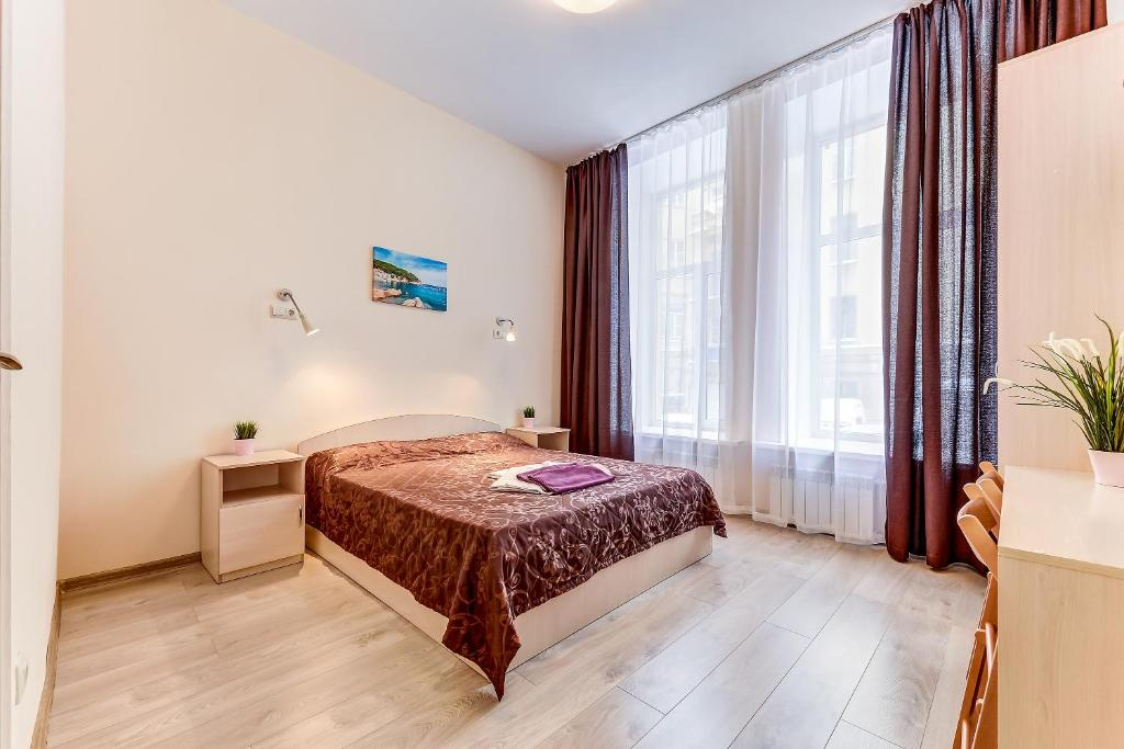 A bed or beds in a room at SuperHostel on Liteyny 41