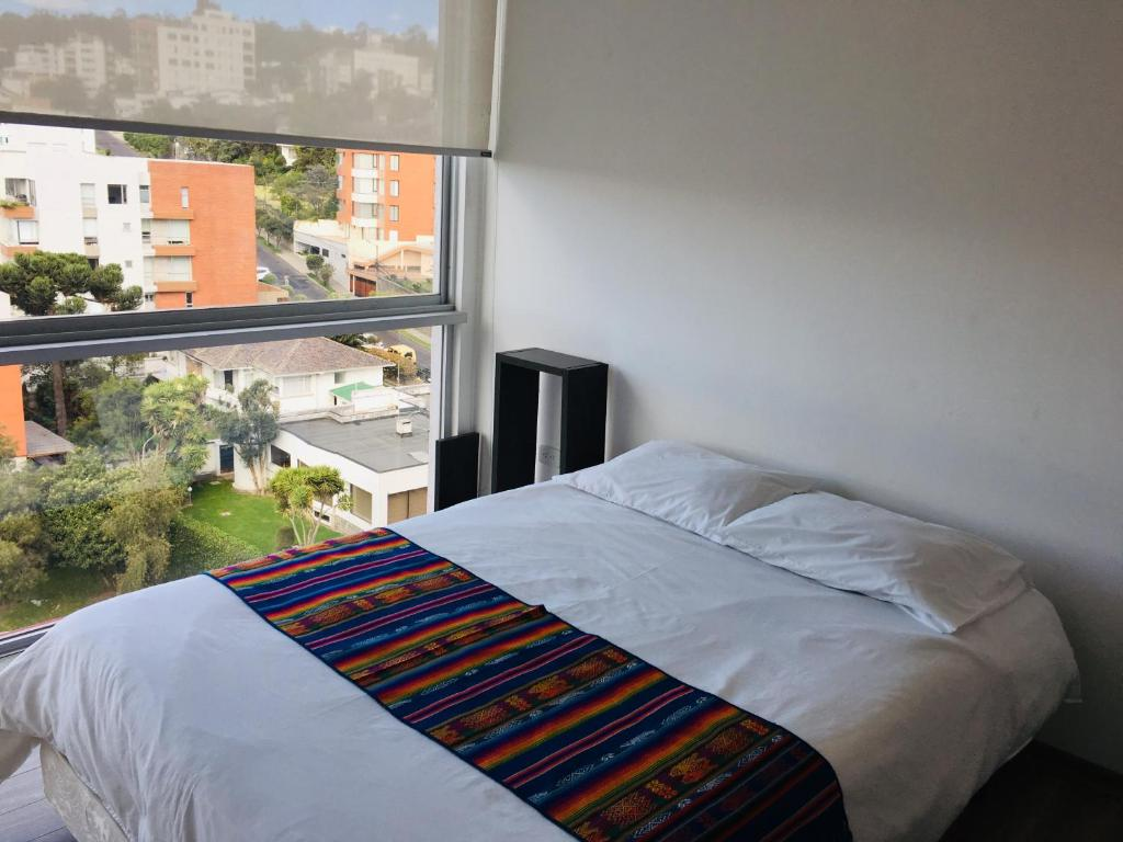 A bed or beds in a room at Departamentos Elite