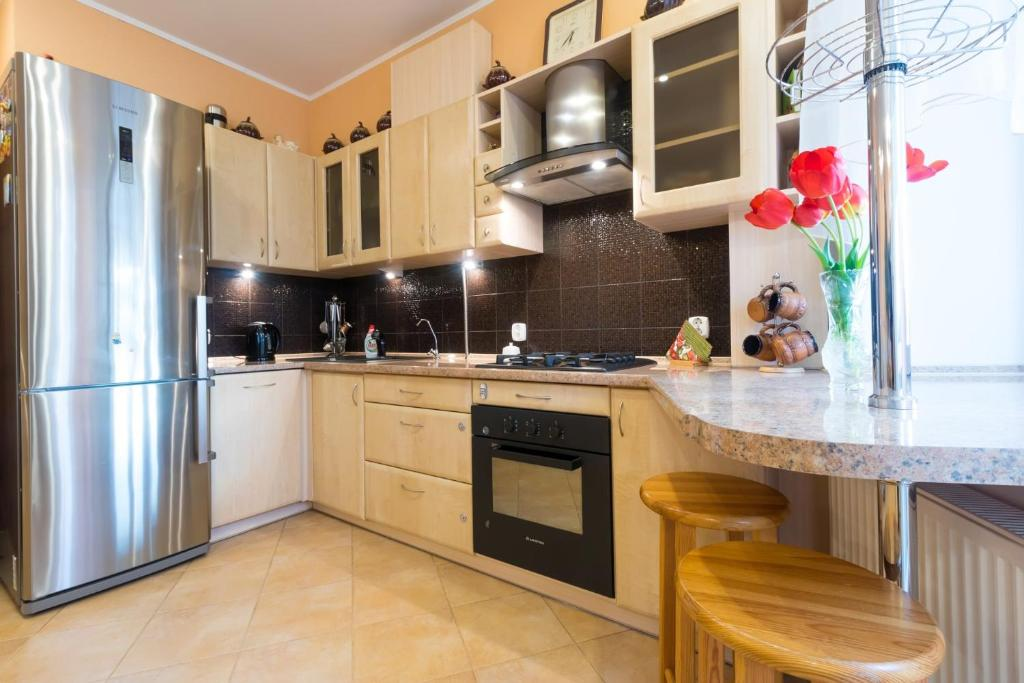 A kitchen or kitchenette at Apart39 on Gaidara 175
