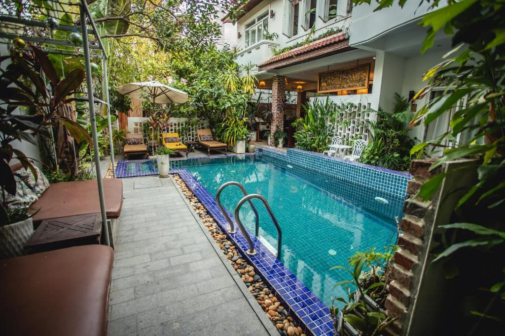 The swimming pool at or close to VMANSION Boutique Hotel