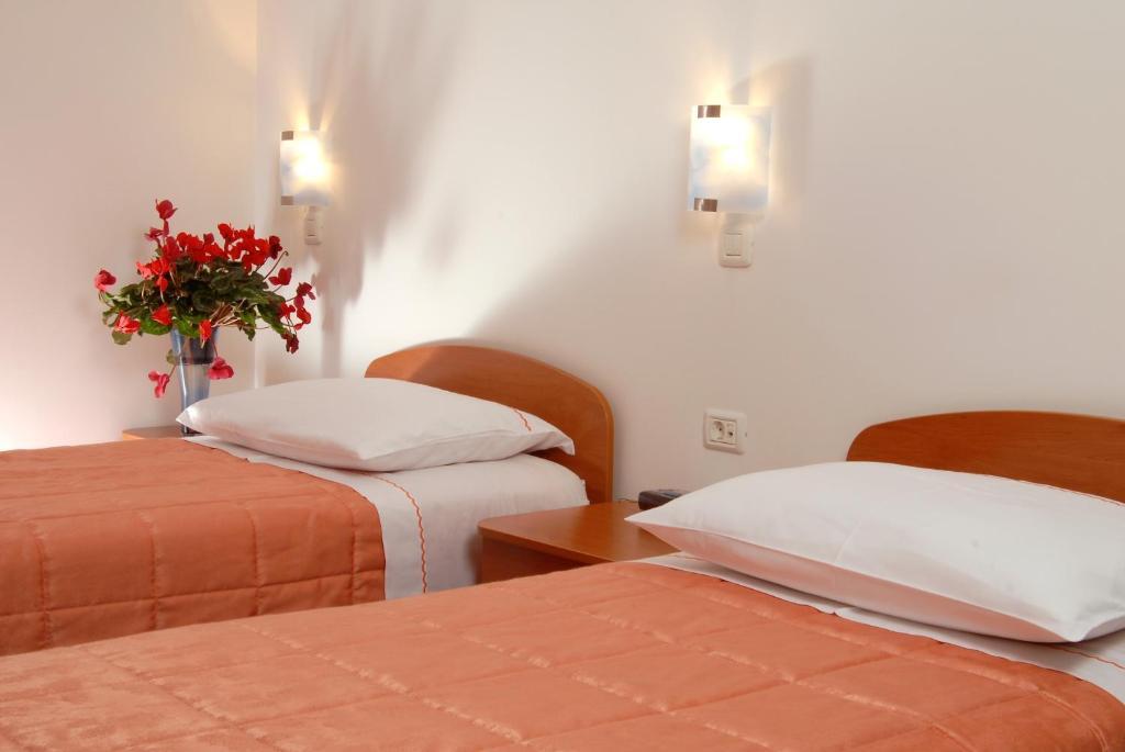 Postelja oz. postelje v sobi nastanitve Guesthouse Bajc