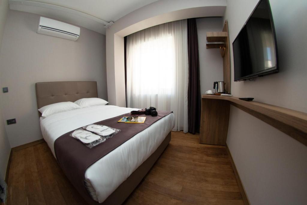 Cama o camas de una habitación en Jurnal Hotel