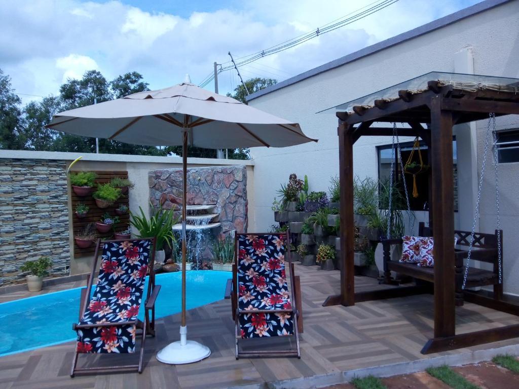 The swimming pool at or near Pousada Bom Sono