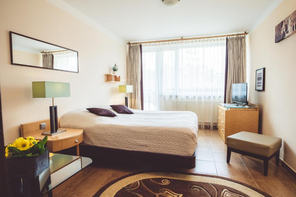 Łóżko lub łóżka w pokoju w obiekcie OW Mikomania