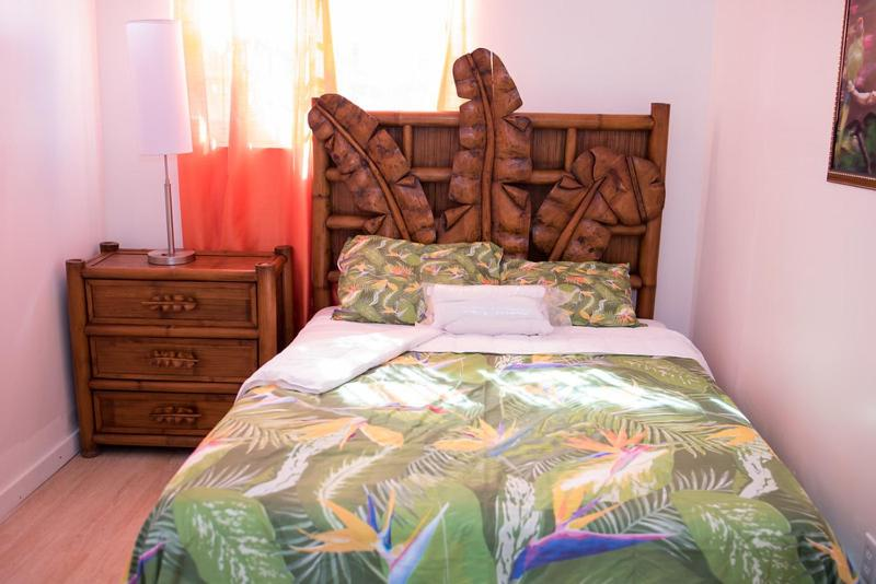 A bed or beds in a room at Cocoplum Rest N Hideaway #1