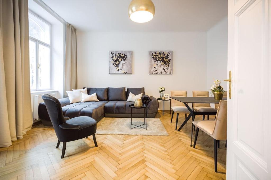 Ein Sitzbereich in der Unterkunft Exclusive Apartment Così fan tutte