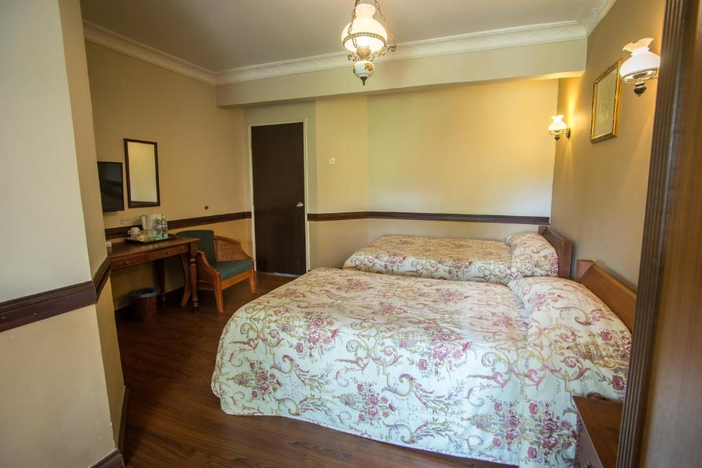 A bed or beds in a room at The Bala's Holiday Chalet