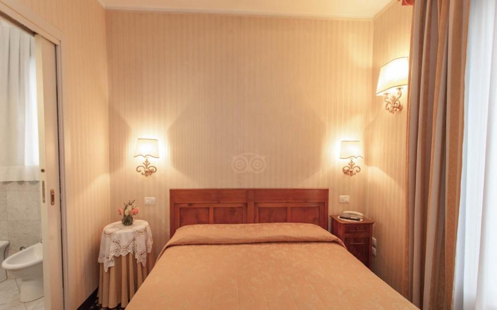 A bed or beds in a room at Ca' Nova