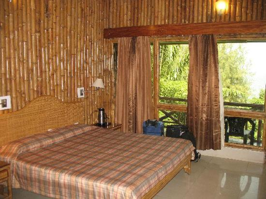 A bed or beds in a room at Megapode Resort